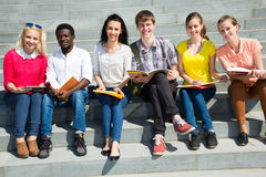 Group of university students studying. Reviewing homework Royalty Free Stock Images