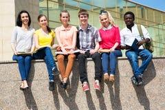 Group of university students studying stock photo