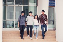 Group of university students walking outside together in campus, Happy Diverse students team concept. royalty free stock photography