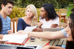 Group Of University Students Working On Project Outdoors Royalty Free Stock Photo