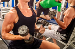 Group of unrecognizable men working his body at gym. Royalty Free Stock Photo