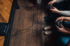 Group of unrecognizable people play video game Stock Images