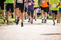 Group of unrecognizable runners outdoors. Long distance running. Stock Photos