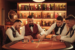 Group of upper class men playing poker in gentlemen`s club. Group of men playing poker in gentlemen`s club Royalty Free Stock Photography