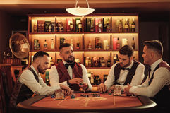 Group of upper class men playing poker in gentlemen`s club Royalty Free Stock Photos