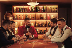 Group of upper class men playing poker in gentlemen`s club Royalty Free Stock Photography