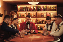 Group of upper class men playing poker in gentlemen`s club. Group of men playing poker in gentlemen`s club Royalty Free Stock Photos