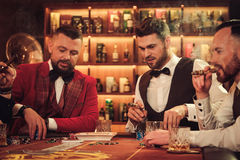 Group of upper class men toasting in gentlemen`s club Royalty Free Stock Photography