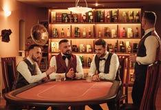 Group of upper class men toasting in gentlemen`s club Stock Photos