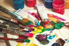 Group of used brushes and a color palette. artist set of ideas o royalty free stock photo