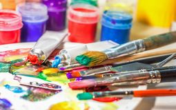 Group of used brushes and a color palette. artist set of ideas o royalty free stock photography