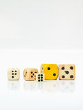 A group of used dice  on white background. Stock Photography