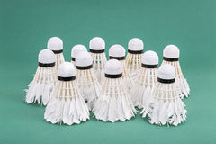 Group of used and worn out badminton shuttlecock on green cour Royalty Free Stock Photos