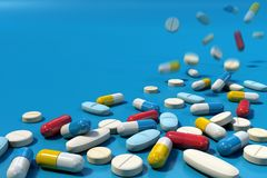 Group of various medicine pills falling on blue surface royalty free illustration