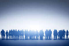 Group of various people looking towards light, future. Group of various people silhouettes standing and looking towards light. Concept of society, community Stock Photography