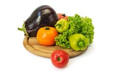 Group of vegetables. Colorful fresh group of vegetables on a wooden board. White background Royalty Free Stock Image