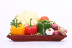 Group of Vegetables. Group different coloured vegetables on wooden tray Royalty Free Stock Photography