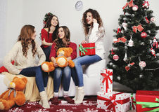 Group of very young women talk about  gifts in Stock Photo