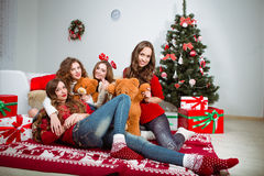 Group of very young women talk about  gifts in Stock Image