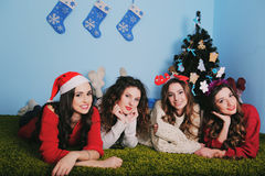 Group of very young women talk about  gifts in Royalty Free Stock Image