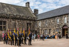 Group of veterans with flags at Scottish National War Memorial a royalty free stock image