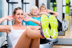 Group on vibrating plates in gym training Stock Images
