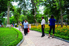 Group of Vietnamese seniors practice Tai Chi early in the morning on the bank of Hoan Kiem lake on september 1, 2015 in Hanoi. Stock Photography