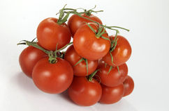 Group Of Vine Ripened Tomatoes On The Vine Stock Photo