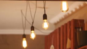 Group of vintage bulb lights with lens flare 3d rendering animation. Lights is turned on stock video footage