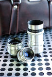 Group of vintage manual photographic camera lenses on metalic ba Royalty Free Stock Image