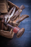 Group of vintage messy tools in wicker box Stock Photography