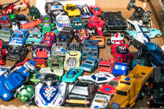 Group of vintage metal miniature cars sold at thrift store. Group of vintage metal small miniature cars sold at garage sale or flea market for second hand use Stock Image