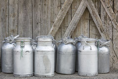 Group of vintage milk cans. Vintage milk cans in rural Northern Italy stock photo