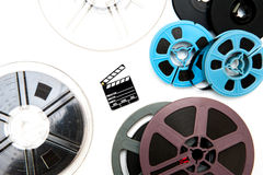 Group of vintage 8mm  reels around little clapper board Stock Photos