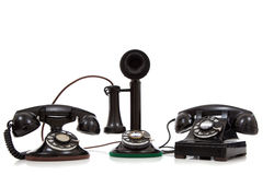 A group of vintage telephones on white Royalty Free Stock Photos