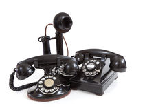 A group of vintage telephones on a white background Royalty Free Stock Photo