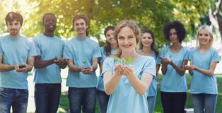 Group of volunteer with trees for growing stock image