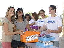 Group of volunteers collecting clothing donations