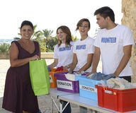 Group of volunteers collecting clothing donations Royalty Free Stock Image