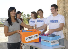 Group of volunteers collecting clothing donations Royalty Free Stock Photos