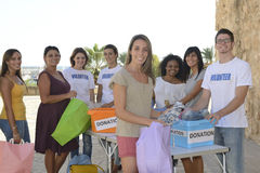 Group of volunteers collecting clothing donations Stock Photos
