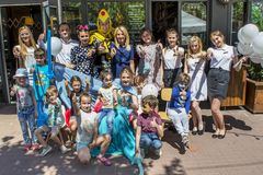 Group of volunteers and entertainers with happy kids during children protection day. In Ukraine stock images