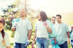 Group of volunteers with garbage bags in park royalty free stock image