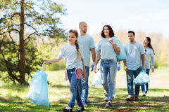 Group of volunteers with garbage bags in park Stock Images
