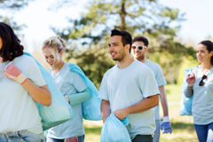 Group of volunteers with garbage bags in park Stock Photo