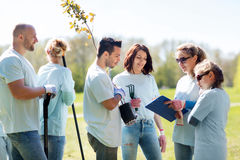 Group of volunteers planting trees in park Stock Photos
