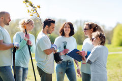 Group of volunteers planting trees in park Royalty Free Stock Image