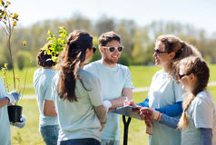 Group of volunteers planting trees in park Royalty Free Stock Photography