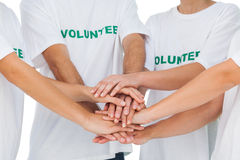 Group of volunteers putting hands together Stock Photography
