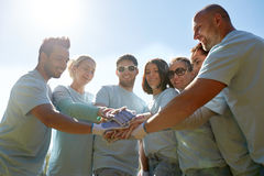 Group of volunteers putting hands on top outdoors Royalty Free Stock Photography